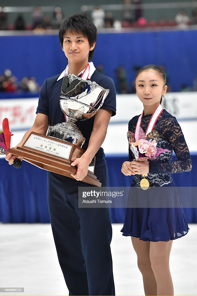 Narumi Takahashi and Ryuichi Kihara of Japan pose with gold medal in the award ceremony for Pairs during the 83rd All Japan Figure Skating Championships at the Big Hat on December 28, 2014 in Nagano, Japan.