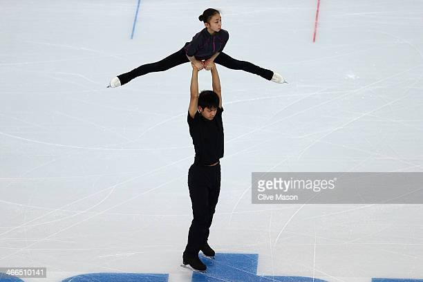 Narumi Takahashi and Ryuichi Kihara of Japan practice their pairs routine ahead of the Sochi 2014 Winter Olympics at Iceberg Skating Palace on...