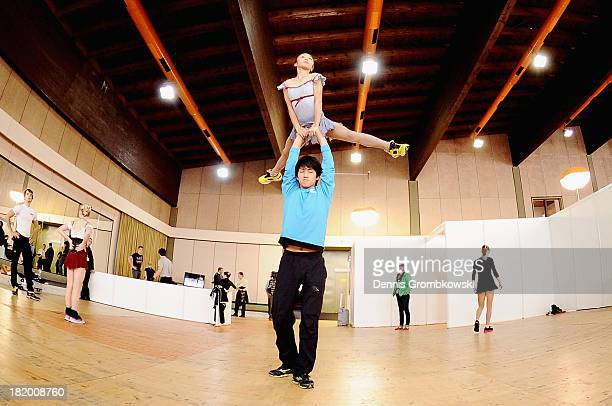 Narumi Takahashi and Ryuichi Kihara of Japan warm up prior to the Pair's Free Skating competition during day two of the ISU Nebelhorn Trophy at...