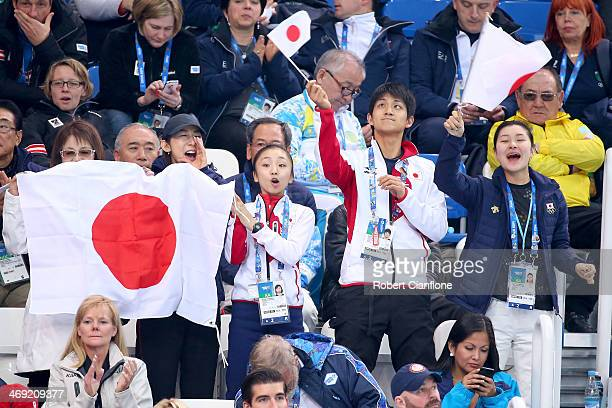 Narumi Takahashi Ryuichi Kihara and Kanako Murakami and Japanese supporters cheer during the Men's Figure Skating Short Program on day 6 of the Sochi...