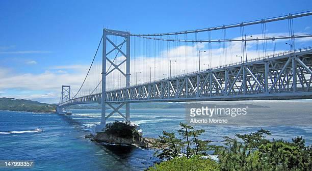 naruto bridge over river - naruto stock photos and pictures