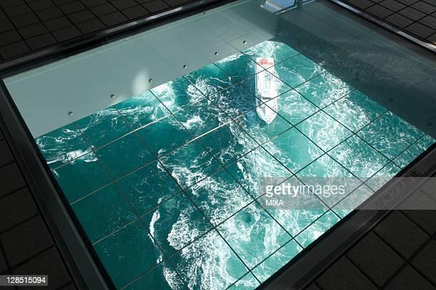 naruto whirlpool from observation room of uzu-no-michi, naruto, tokushima, japan - naruto stock photos and pictures