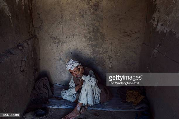 Naryalay from Kunar province sits chained in a concrete cell of the Mia Ali Sahib shrine outside Jalalabad Afghanistan on October 19 2012 Relatives...