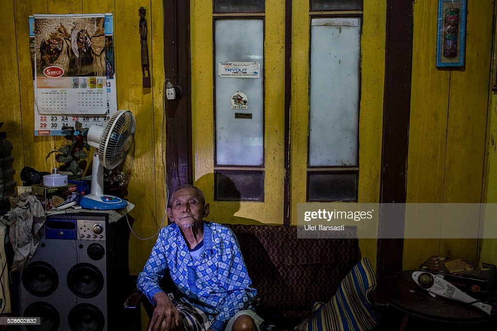 Naryo, 92 years old, sits inside his house on May 05, 2016 in Kendal, Central Java. Naryo, was a village official who are not connection with any political party, who imprisoned without trial because having similar names with others for suspected ties to the Indonesian Communist Party (PKI). Survivors of Indonesia's anti-communist massacres in 1965 called for investigations on the country's purges, in which hundreds of thousands of people are believed to have been killed by the Indonesian military when the Cold War was escalating in Southeast Asia. Based on human rights groups, half a million people died in 1965 during a massacre carried out by the military and religious groups after an attempted coup by suspected communists, where an officer-led group kidnapped and executed six generals on the night of Septemeber 30, 1965. Known as one of the worst mass atrocities of the 20th century, many among the dead had no connection to Communism, and hundreds of thousands had been held in dentention centers for years during the period.