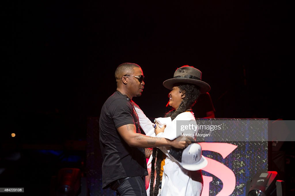 Nas and Erykah Badu on stage at Chene Park Amphitheater on August 15, 2015 in Detroit, Michigan.