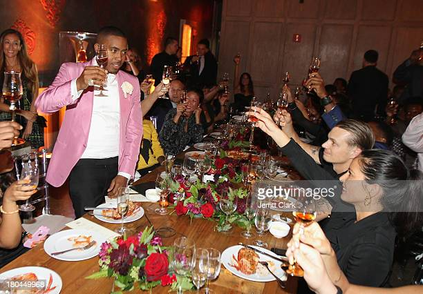 Nas, Joel Kinnaman and Olivia Munn toast at Nas 40th Birthday Celebration Dinner And Party at Avenue NYC on September 12, 2013 in New York City.