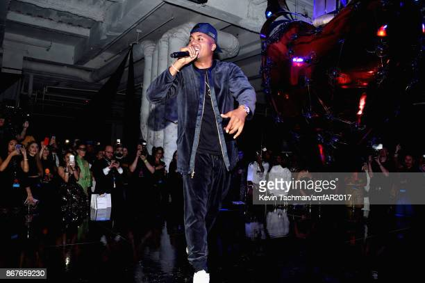 Nas performs at 2017 amfAR The Naked Heart Foundation Fabulous Fund Fair at Skylight Clarkson Sq on October 28 2017 in New York City