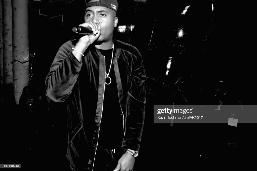 Nas performs at 2017 amfAR & The Naked Heart Foundation Fabulous Fund Fair at Skylight Clarkson Sq on October 28, 2017 in New York City.