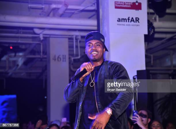 Nas performs on stage during Moet Hennessy at The 2017 amfAR and The Naked Heart Foundation Fabulous Fund Fair on October 28 2017 in New York City
