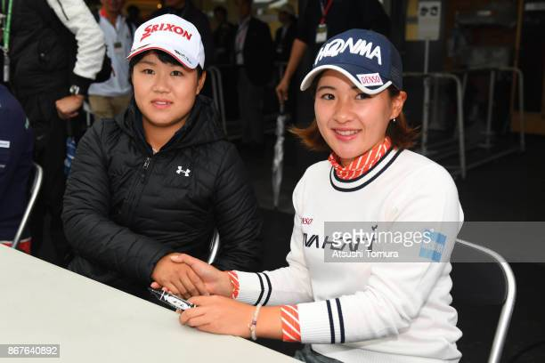 Nasa Hataoka and Kana Nagai of Japan attend autograph session after the final day has cancelled because of rain storm during the final round of the...