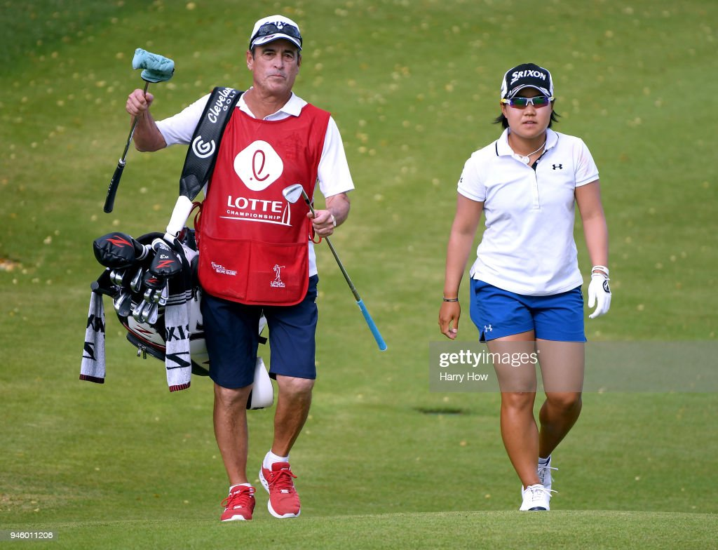Nasa Hataoka of Japan and caddie Dana Derouaux, make their way to the 18th green during the third round of the LPGA LOTTE Championship at the Ko Olina Golf Club on April 13, 2018 in Kapolei, Hawaii.