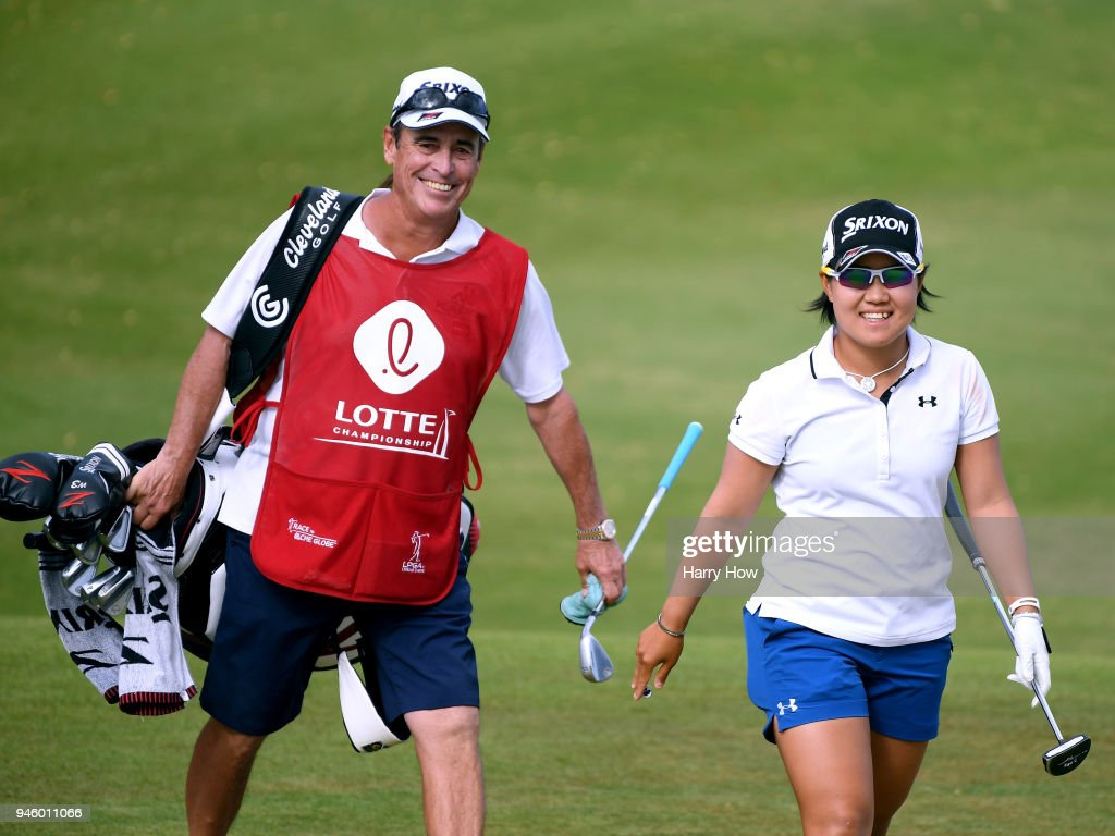 Nasa Hataoka of Japan and caddie Dana Derouaux react after a chip on the 18th green during the third round of the LPGA LOTTE Championship at the Ko Olina Golf Club on April 13, 2018 in Kapolei, Hawaii.