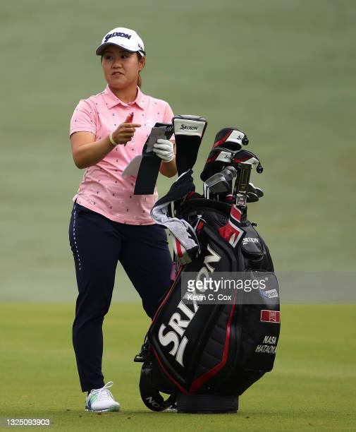Nasa Hataoka of Japan converses with her caddie on the 10th hole during a practice round for the KPMG Women's PGA Championship at Atlanta Athletic...