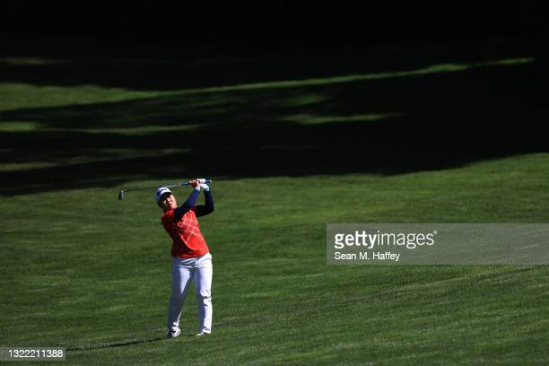 Nasa Hataoka of Japan hits an approach shot on the 18th hole playoff against Yuka Saso of the Philippines during the final round of the 76th U.S....