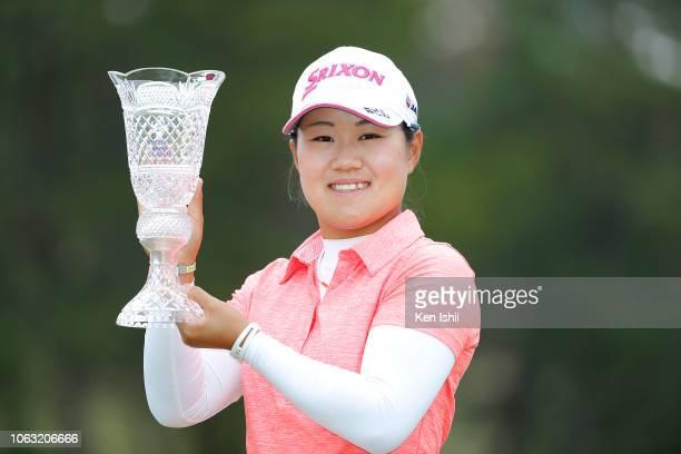 Nasa Hataoka of Japan holds the winner's trophy after winning the TOTO Japan Classic at Seta Golf Course on November 04 2018 in Otsu Shiga Japan