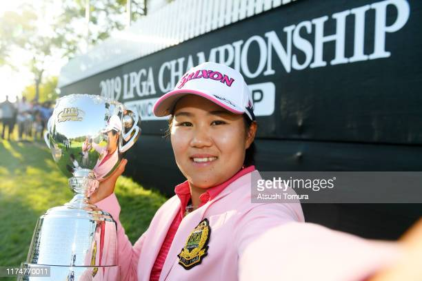 Nasa Hataoka of Japan imitates the selfie with the trophy after the award ceremony following the final round of the 52nd LPGA Championship Konica...