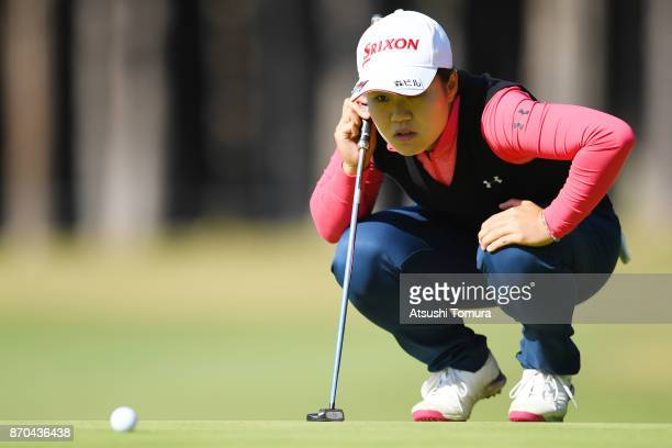 Nasa Hataoka of Japan lines up a putt on the 9th hole during the final round of the TOTO Japan Classics 2017 at the Taiheiyo Club Minori Course on...