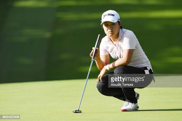 Nasa Hataoka of Japan lines up her putt on the 16th hole during the second round of Japan Women's Open 2017 at the Abiko Golf Club on September 29...
