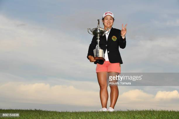 Nasa Hataoka of Japan poses with the trophy after winning the Japan Women's Open 2017 at the Abiko Golf Club on October 1 2017 in Abiko Chiba Japan