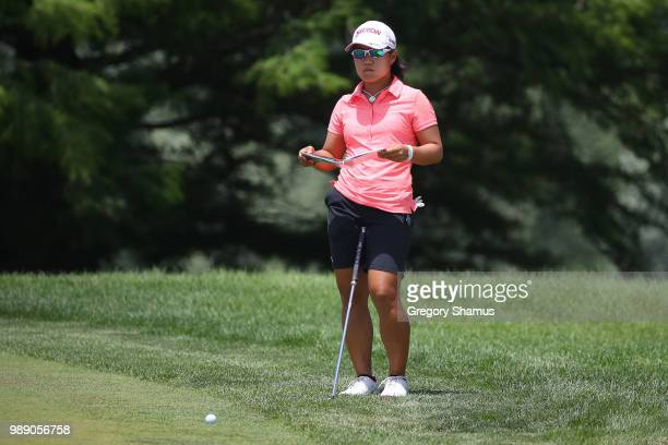 Nasa Hataoka of Japan reads a putt on the 18th green during the final round of the 2018 KPMG PGA Championship at Kemper Lakes Golf Club on July 1...
