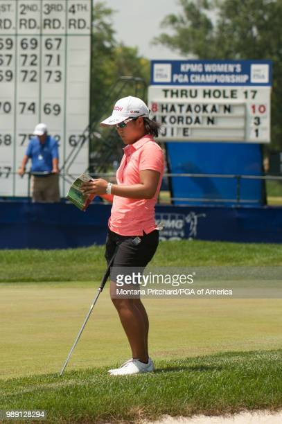 Nasa Hataoka of Japan reads her yardage on the 18th hole during the final round of the 2018 KPMG Women's PGA Championship at Kemper Lakes Golf Club...
