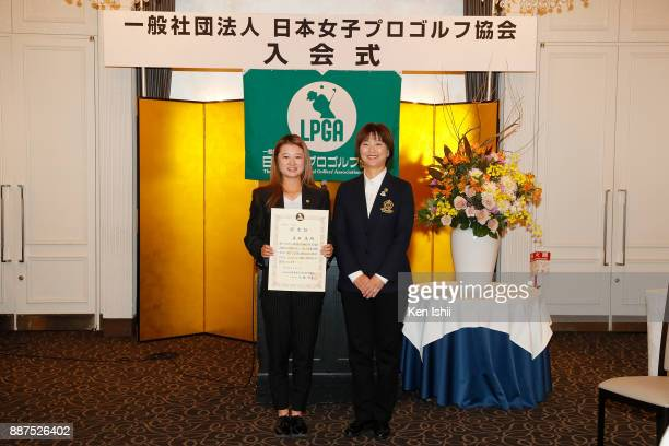 Nasa Hataoka of Japan receives a certificate from LPGA president Hiromi Kobayashi during the Ladies Professional Golfers' Association of Japan...