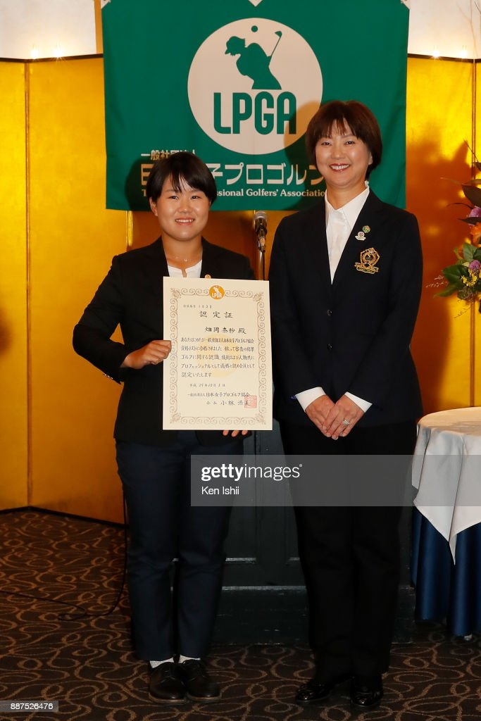 Nasa Hataoka (L) of Japan receives a certificate from LPGA president Hiromi Kobayashi during the Ladies Professional Golfers' Association of Japan induction ceremony at Hotel Monterey Ginza on December 7, 2017 in Tokyo, Japan.