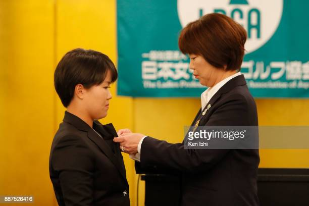 Nasa Hataoka of Japan receives a lapel pin from LPGA president Hiromi Kobayashi during the Ladies Professional Golfers' Association of Japan...