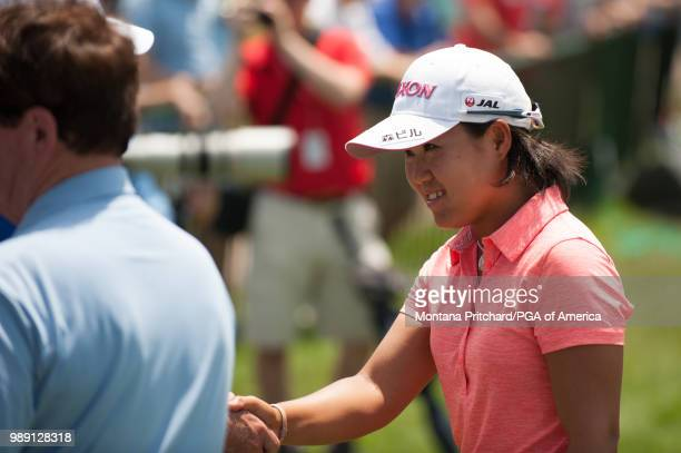 Nasa Hataoka of Japan shakes hands after her round during the final round of the 2018 KPMG Women's PGA Championship at Kemper Lakes Golf Club on July...