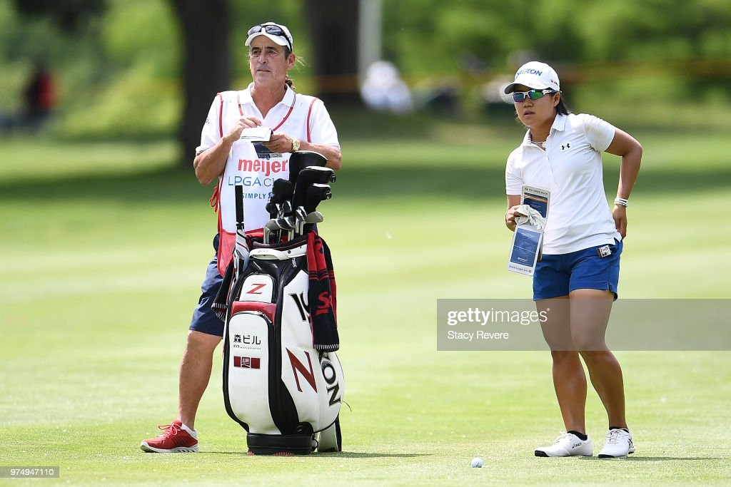 Nasa Hataoka of Japan speaks with her caddie on the eighth hole during the first round of the Meijer LPGA Classic for Simply Give at Blythefield Country Club on June 14, 2018 in Grand Rapids, Michigan.