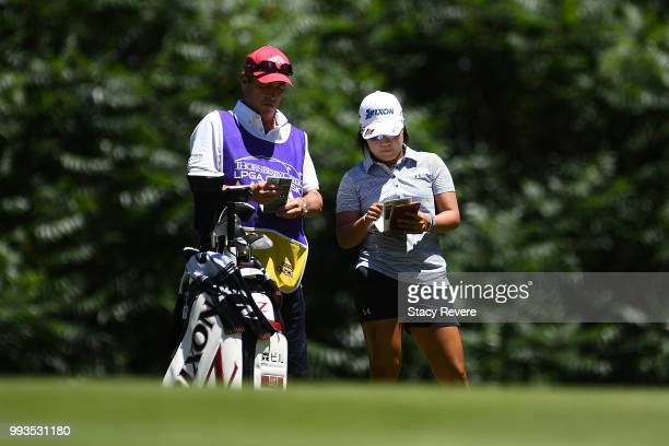 Nasa Hataoka of Japan speaks with her caddie on the first hole during the third round of the Thornberry Creek LPGA Classic at Thornberry Creek at...