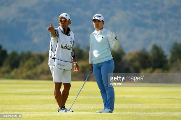 Nasa Hataoka of Japan talks with her caddie on the fifteenth hole during the first round of the TOTO Japan Classic at Seta Golf Course on November 02...