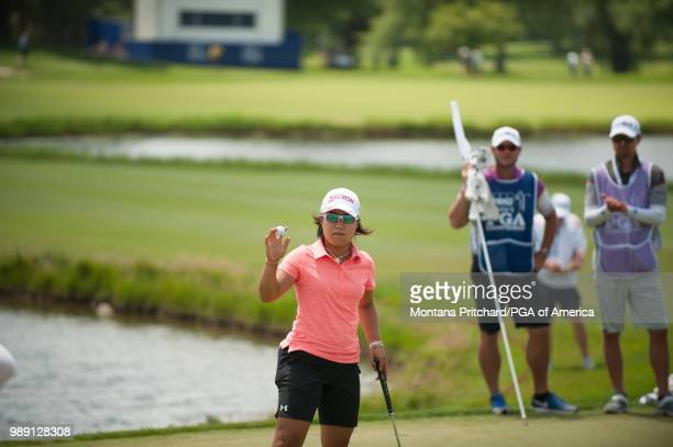 Nasa Hataoka waves after making her putt on the 18th hole during the final round of the 2018 KPMG Women's PGA Championship at Kemper Lakes Golf Club...