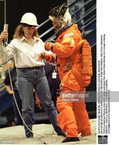 Nasa Technician Sharon Jones, Left, Helps Astronaut Sen. John Glenn During Crew Escape Training Monday, June 1 At Nasa's Johnson Space Center In...