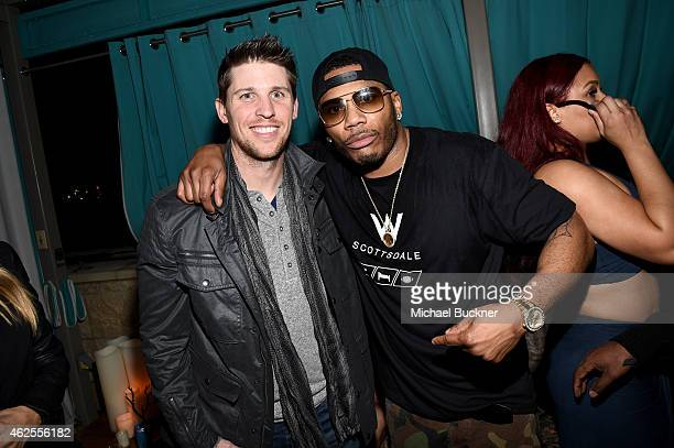 Nascar driver Denny Hamlin and rapper Nelly attend the Playboy Party at the W Scottsdale During Super Bowl Weekend on January 30 2015 in Scottsdale AZ
