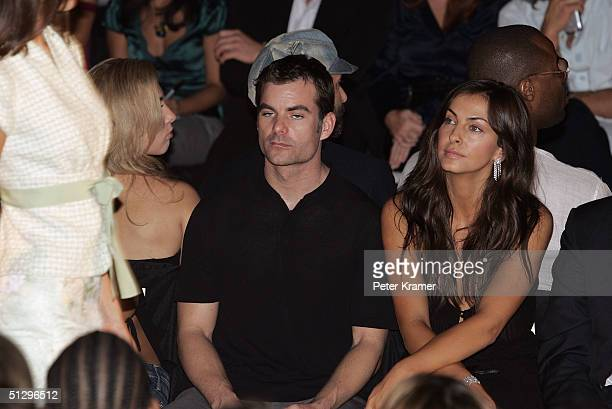 Nascar driver Jeff Gordon and his girlfriend Ingrid Vandebosch attend the Luca Luca Couture Spring 2005 fashion show during the Olympus Fashion Week...