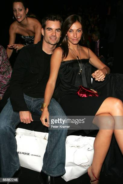 Nascar driver Jeff Gordon and Ingrid Vandebosch pose in the front row at the Luca Luca Spring 2006 fashion show during Olympus Fashion Week at Bryant...