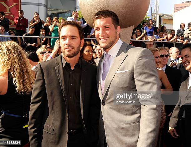 Nascar driver Jimmie Johnson and NFL player Tim Tebow of the New York Jets arrive at the 2012 ESPY Awards at Nokia Theatre LA Live on July 11 2012 in...
