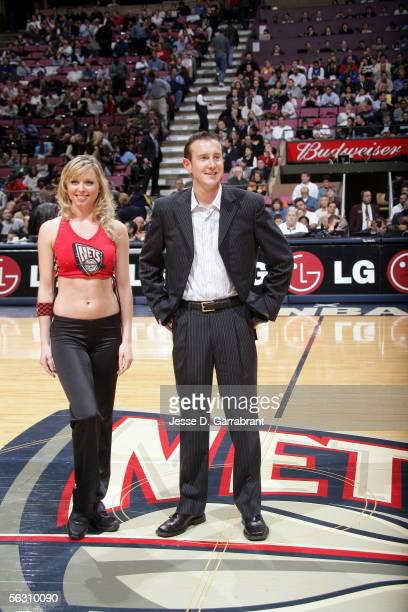 Nascar driver Kurt Busch and a New Jersey Nets dancer at the game between the New Jersey Nets and the Detroit Pistons on November 30 2005 at the...