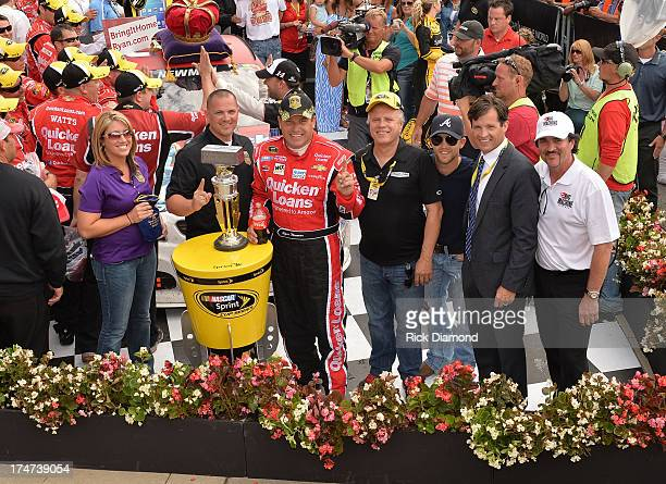 Nascar driver Ryan Newman celebrates after winning the Brickyard 400 with April Deeds Samuel Deeds Justin Moore and Scott Borchetta Presented By Big...