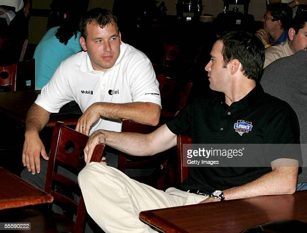 Nascar drivers Ryan Newman and Jimmie Johnson talk at ESPN Zone restaurant during the Chase for the Nascar Nextel Cup Media Day September 15 2005 in...