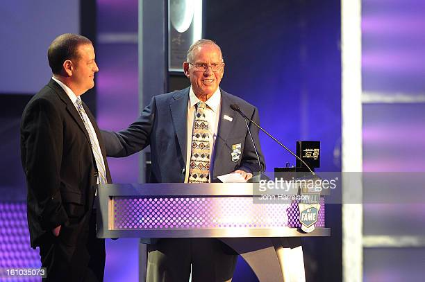 Nascar Hall of Fame Member David Pearson presents The Nascar Hall of Fame ring to Joel Thomas grandson of Hall Of fame inductee Cotton Owens during...