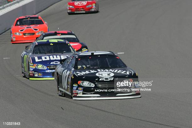Nascar Jimmie Johnson Dave Blaney during the NEXTEL Cup UAWDaimler Chrysler 400 on March 13 2005 in Las Vegas NV Jimmie Johnson won the race