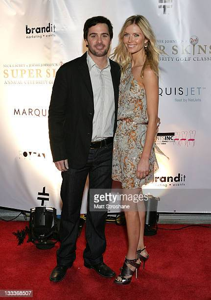 Nascar Sprint Cup driver Jimmie Johnson and wife Chandra Johnson arrive at the Super Skins Kickoff Party hosted by Nick Lachey and Jimmie Johnson at...