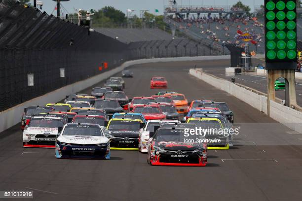 Nascar Xfinity Series driver Busch Kyle of Joe Gibbs Racing leads the field into turn one after the mandatory restart at the NASCAR Xfinity Series...