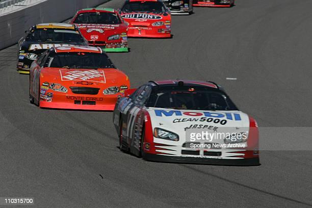 NascarTony Stewart Travis Kvapil during the NEXTEL Cup UAWDaimler Chrysler 400 on March 13 2005 in Las Vegas NV Jimmie Johnson won the race