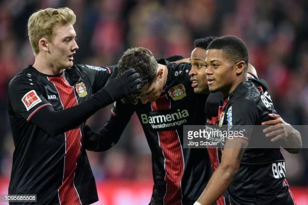 Nascimento Borges Wendell of Leverkusen celebrates with teammates Julian Brandt Kai Havertz and Leon Bailey after scoring the opening goal lead...