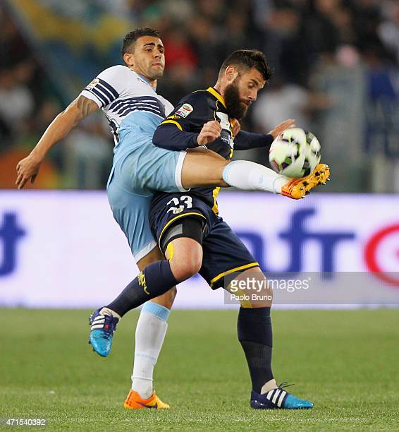 Nascimento Mauricio Dos Santos of SS Lazio competes for the ball with Antonio Nocerino of Parma FC during the Serie A match between SS Lazio and...