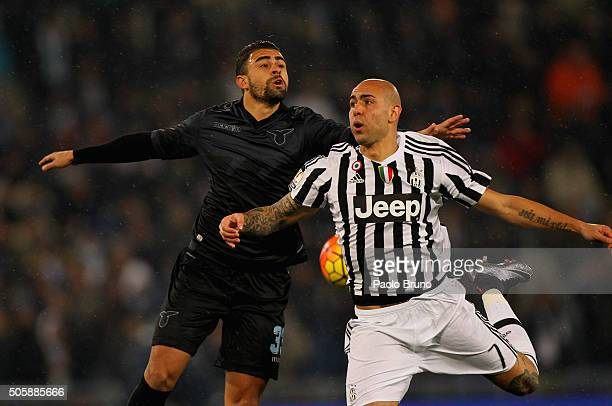 Nascimento Mauricio Dos Santos of SS Lazio competes for the ball with Simone Zaza of Juventus FC during the TIM Cup match between SS Lazio and...