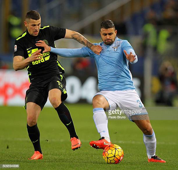 Nascimento Mauricio Dos Santos of SS Lazio competes for the ball with Pawel Wszolek of Hellas Verona FC during the Serie A match between SS Lazio and...